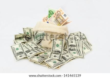 Canvas money sack with one hundred dollar isolated on white background - stock photo