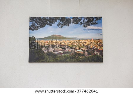 Canvas print of landscape scenery hung up on wall.
