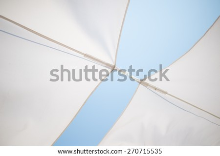 Canvas roof in blue sky day. - stock photo