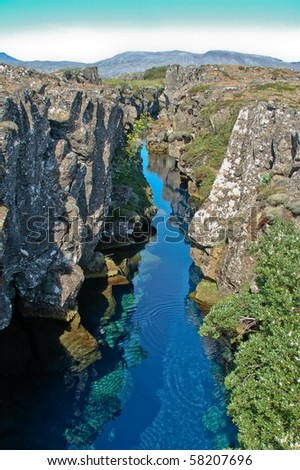 Canyon filled with hot water  at Pingvellir, Iceland - stock photo