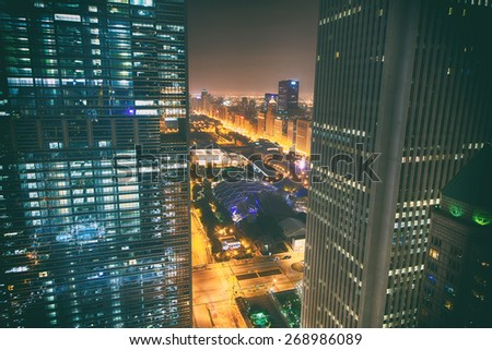 Canyon-like view of Chicago Skyline at night with lights and view of Grant Park and Michigan Avenue - stock photo
