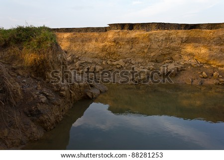 Canyon road. Condition of the road to water erosion as the cliff. - stock photo