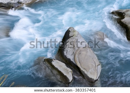 Canyon  rocks with powerful stream