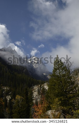 Canyon views of Grand Teton covered in clouds - stock photo