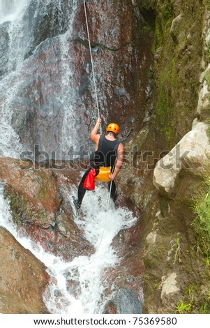 CANYONING ON PUCAYACU WATERFALL CANYON NEAR BANOS, ECUADOR