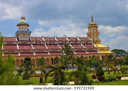 Cao Dai Temple in Tay Ninh near Ho Chi Minh City (Saigon) in Vietnam - stock photo