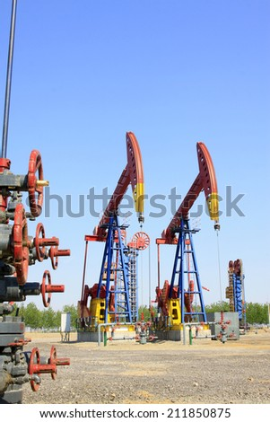 CAOFEIDIAN - MAY 2: crank balanced beam pumping unit in the JiDong oilfield, on may 2, 2014, caofeidian, hebei province, China.