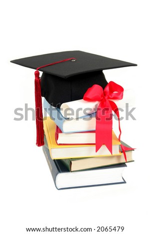 Cap and diploma on top of stack of books - stock photo