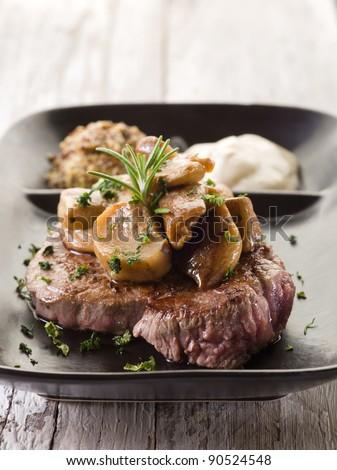 cap mushroom over grilled tenderloin and mustard sauce - stock photo