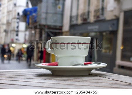 Cap of coffee and street cafe. - stock photo