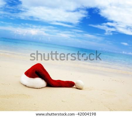 cap of Santa and caribbean sea - stock photo