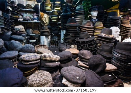 cap on market.   hats, berets and other headdress - stock photo