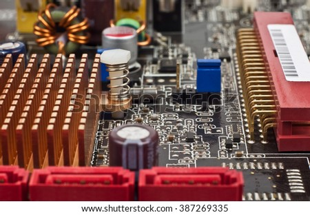 capacitors, chips, radiators, fuses inside the computer - stock photo