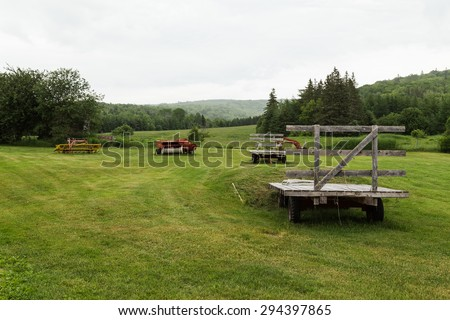 CAPE BRETON, CANADA - 5TH JULY 2015: Lots of Farm equipment in a field during an overcast day in the summer