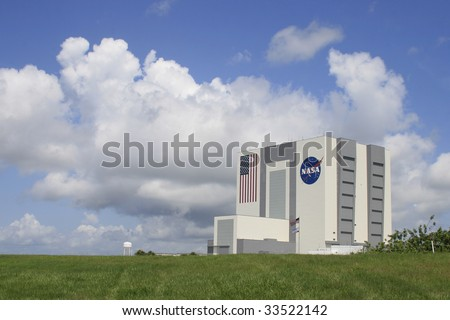 CAPE CANAVERAL, FL - JULY 11: Clouds form around NASA's Vehicle Assembly Building prior to the canceled launch of launch of STS-127 from Kennedy Space Center on July 11, 2009 in Cape Canaveral, Fl. - stock photo