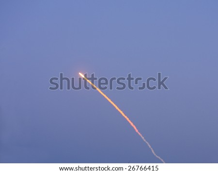 CAPE CANAVERAL, FL - March 15: Vapor trail of Space Shuttle Discovery as it launches successfully from Cape Canaveral at 7:43 PM EST. - stock photo