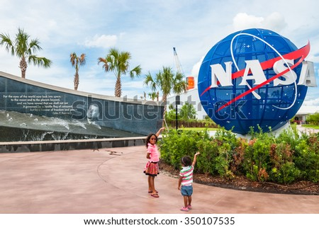 CAPE CANAVERAL, FLORIDA - JUNE 7, 2013: The Rocket Garden at Kennedy Space Center NASA.  Tourist attraction NASA Globe, rockets from past explorations for every USA human space flight since 1968 - stock photo