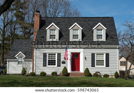 Three story residential home stock images royalty free for Cape dormers