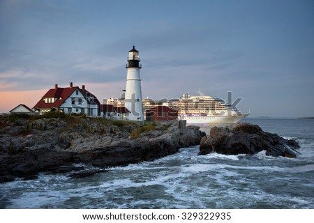 CAPE ELIZABETH, ME - OCTOBER 6, 2015 - Carnival Splendor cruise ship sails behind Portland Head Lighthouse. Fall is peak cruise ship season for New England, due to seasonable weather and fall foliage.
