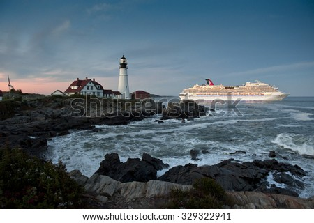CAPE ELIZABETH, ME - OCTOBER 6, 2015 - Carnival Splendor cruise ship sails past Portland Head Lighthouse. Fall is peak cruise ship season for New England, due to seasonable weather and fall foliage. - stock photo