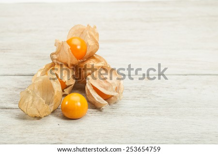 cape gooseberry on white wooden table. - stock photo