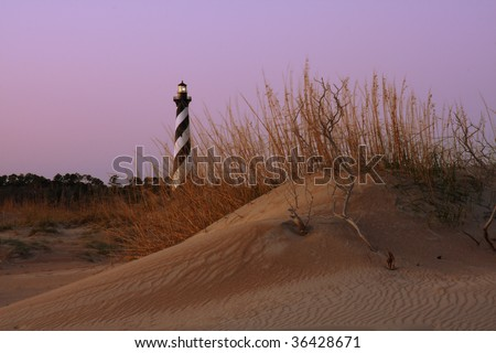 Cape Hatteras Lighthouse, Outer banks, North Carolina, with sand dunes in foreground - stock photo