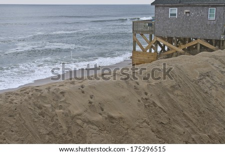 CAPE HATTERAS, NORTH CAROLINA, USA - OCTOBER 18, 2013:  Man Made sand ocean barrier to protect against hurricanes on October 18, 2013 on Cape Hatteras Beach in the Outer Banks of North Carolina