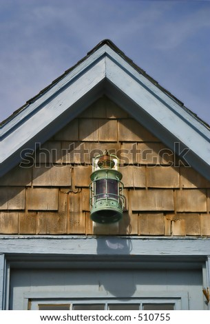 Cape house rooftop with a lantern light - stock photo