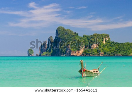 Cape in Loh Dalum bay with boat on foreground, Phi-Phi Don island, Thailand