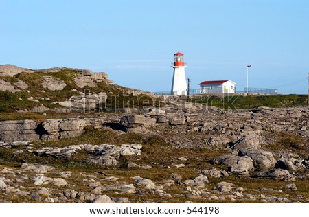 Cape Norman Lighthouse located at the north end of the Northern Peninsula in Newfoundland, Canada. - stock photo