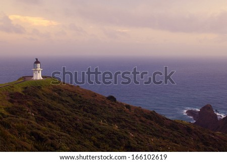 Cape Reinga, Northland, North Island, northernmost tip of New Zealand with Cape Reinga Lighthouse in early morning light, New Zealand - stock photo