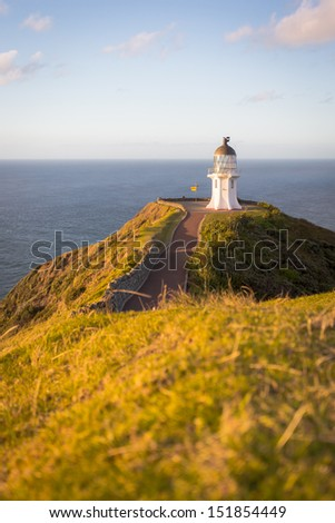 Cape Reinga on the North Island of New Zealand. Pacific Ocean hitting the Tasman Sea. - stock photo
