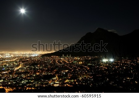 Cape Town city at night with moon in the sky - stock photo