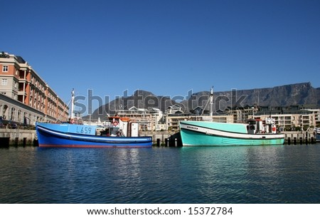 Cape Town Harbor overlooked by Table Mountain (South Africa) - stock photo