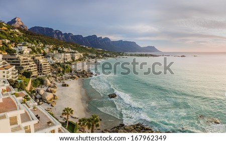 Cape Town's beaches in summer with Table Mountain & Twelve Apostles in the background - stock photo