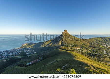 Cape Town's Table Mountain, Lions head & Twelve Apostles are popular hiking destinations for both locals and tourists all year round. - stock photo