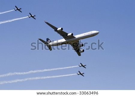 CAPE TOWN, SA - 22 SEPTEMBER 2008: A South African Airways jumbo jet and South African Air Force airplanes flying in close formation at an air show in Cape Town, South Africa on 22 September 2008.