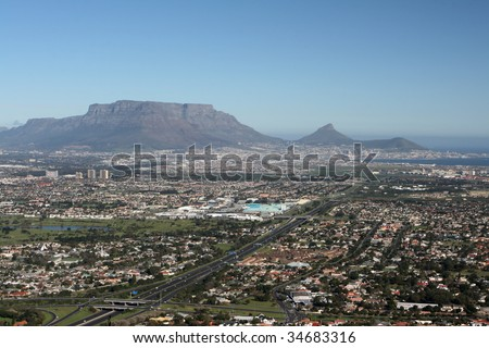 Cape Town, South Africa and the world famous landmark Table Mountain. - stock photo