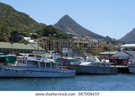 CAPE TOWN, SOUTH AFRICA - CIRCA FEBRUARY 2014: Boats in the False Bay Marina with mountains in the background