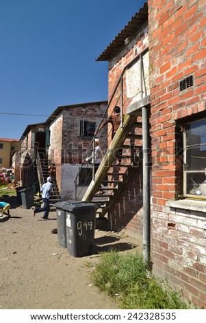 CAPE TOWN, SOUTH AFRICA - JANUARY 26, 2013: Accomodation building mande of bricks in  informal settlement Langa town ship - stock photo