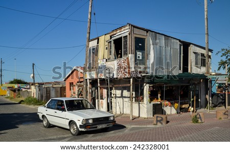 CAPE TOWN, SOUTH AFRICA - JANUARY 26, 2013: Grocery shop: Crumbling shack-like building in  informal settlement Langa town ship - stock photo