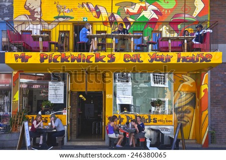 Cape town, South Africa - March 5 2010: Tourists in a restaurant with colored graffiti in Long street
