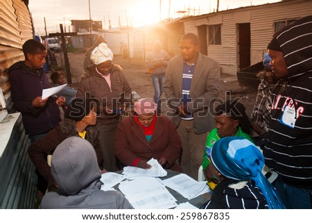 CAPE TOWN, SOUTH AFRICA - MAY 18: Voters gather at the tolling booths during the municipal elections, in Cape Town, South Africa on May 18, 2011 - stock photo
