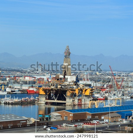 CAPE TOWN, SOUTH AFRICA-OCTOBER, 14: Semi Submersible drilling rig parked in the middle of the shipyard in downtown of Cape Town to get maintenance on October 14, 2013 in Cape Town, South Africa.