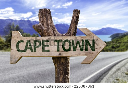 Cape Town wooden sign with a beach on background - stock photo