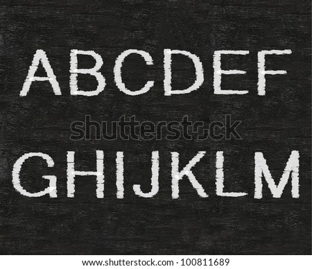 capital letters of English alphabet collection set, white and colors chalk writing on blackboard background - stock photo