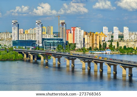 Capital of Ukraine - Kiev. Paton bridge and new residential district on the left coast of Dnieper in Kyiv. - stock photo