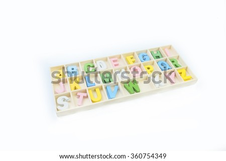 Capital wooden block letter ABC alphabet set in a wood box in white - stock photo