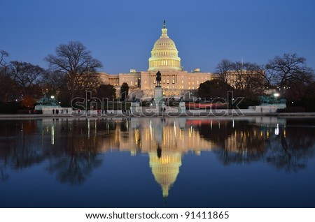 Capitol Building and mirror reflection on pond  in sunrise, Washington D.C. United States - stock photo