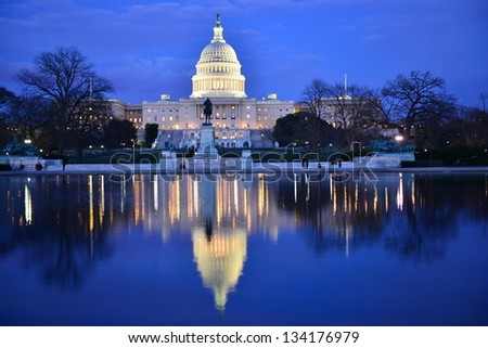 Capitol Building at dusk with reflection pool and blue sky, Washington DC - stock photo